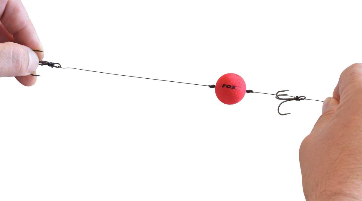 Die Platzierung des oberen Hakens wird bestimmt durch die Köderfischgröße.