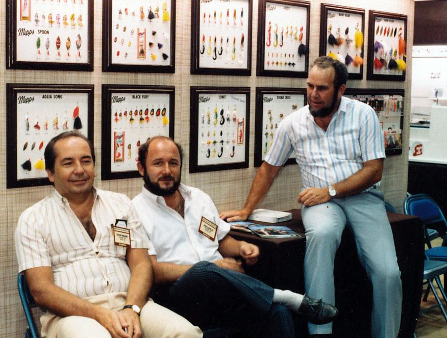 Gerard Monjanel, Jean-Claude Bel und Jan Eggers auf dem Mepps-Stand einer AFTMA-Messe in den USA.
